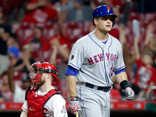 New York Mets' Devin Mesoraco reacts after striking out against Cincinnati Reds relief pitcher Austin Brice during the ninth inning of a baseball game Tuesday, May 8, 2018, in Cincinnati. (AP Photo/John Minchillo)