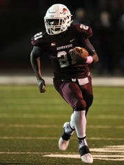 Thomas Metthe/Reporter-News Brownwood running back Gavin Jefferson (21) runs the ball during the first quarter of the Lions' 35-13 loss to Wylie on Friday, Oct. 7, 2016, at Gordon Wood Stadium in Brownwood.