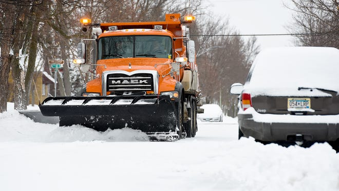 St. Cloud Public Works Department snowplows clear snow Monday, March 5, off the streets near Technical High School.