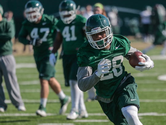 Michigan State University running back Madre London  (28) moves the ball during the first spring practice of Michigan State University football team on Tuesday March 24, 2015 at the Duffy Daugherty Football Building on the Michigan State University campus in East Lansing.