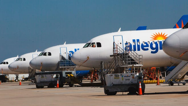 In this file photo from March, Allegiant planes are lined up at Punta Gorda Airport.