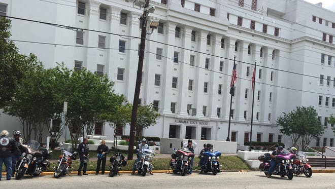 Motorcyclists affiliated with American Bikers Aimed Toward Education arrive at the State House.