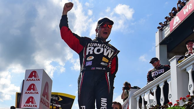 Martin Truex Jr. celebrates in victory lane after winning for the first time in nearly two years.