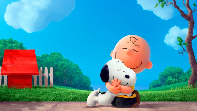 """This photo provided by Twentieth Century Fox Film Corporation shows Snoopy and Charlie Brown from Charles Schulz's timeless """"Peanuts"""" comic strip in their big-screen debut in a CG-animated feature film in 3D, """"The Peanuts Movie."""" The movie releases in U.S. theaters Nov. 6, 2015. (Blue Sky Animation/Twentieth Century Fox Film Corporation via AP)"""