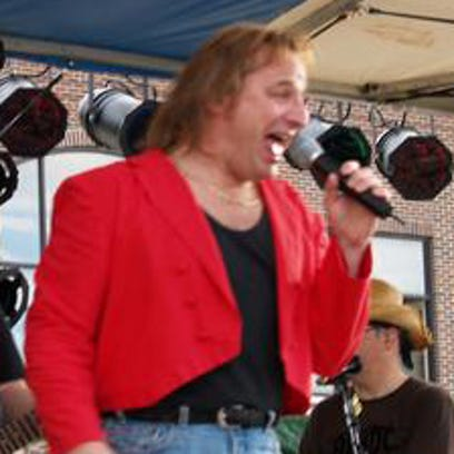 Paul Lent, right, of Green Bay-based Journey tribute band Separate Ways (and of the band Replica), won Male Vocalist of the Year at the Wisconsin Area Music Industry Awards on Sunday night in Milwaukee.