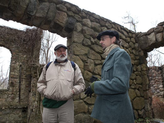Thom Johnson, left, and Rob Yasinsac stand by the ruins of Northgate, a former estate in Cold Spring, April 29, 2014. They have spearheaded efforts to preserve what remains of the stone structures and have planned a clean-up for this coming weekend.