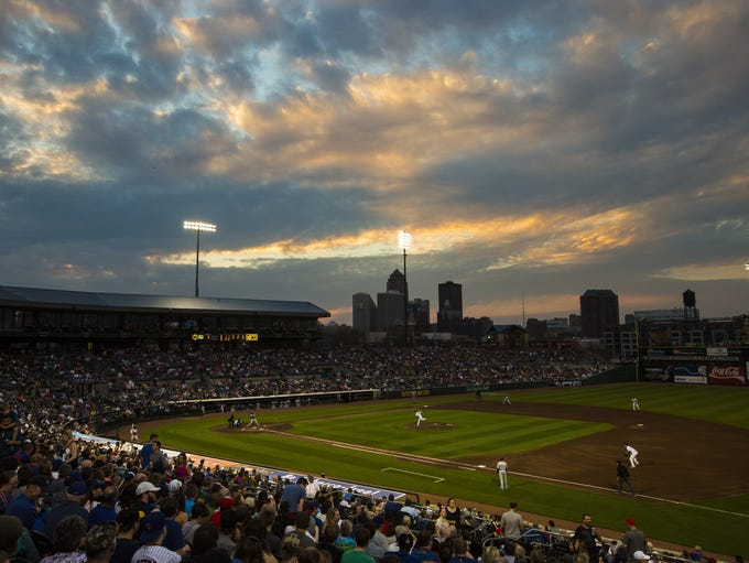 The sun sets over the Iowa Cubs home opener Friday,