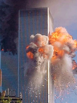 A fireball explodes from one of the World Trade Center towers after a jet airliner crashed into the building Tuesday, Sept. 11, 2001, in New York.