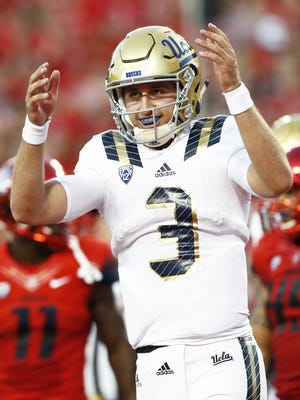 UCLA quarterback Josh Rosen (3) celebrates his 5-yard touchdown pass to Jordan Payton against Arizona in the first half on Sep. 26, 2015 in Tucson, AZ.