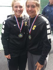 Tori Lewis (left) and JaJa Osuna pose with their district championship medals.