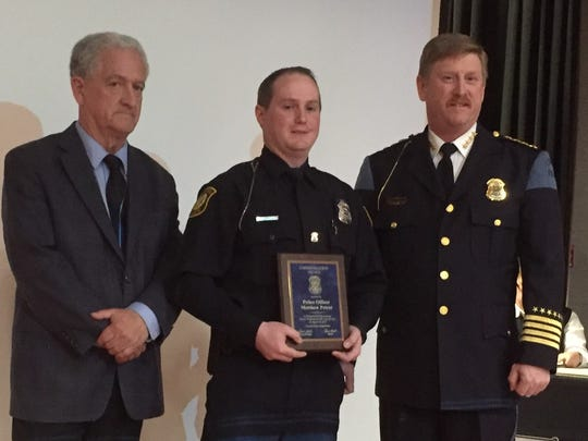 Officer Matthew Petrul, pictured here on Tuesday with Mayor Dennis Wright and Police Chief Curtis Caid, received a Commendation Award for his pursuit and arrest of a robbery suspect.