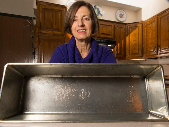 Maryjane Ingersoll is shown with a worn pan used by her late uncle to make Hungarian nut cake, a cherished family holiday recipe.