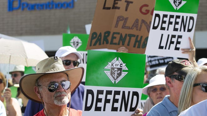 Wes Harris of Phoenix rallies against Planned Parenthood during simultaneous protests in support of and opposed to Planned Parenthood at the Planned Parenthood Arizona headquarters in Phoenix on Saturday, August 22, 2015.