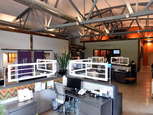 The office space uses an open floor plan with a few office on the perimeter of the space.
