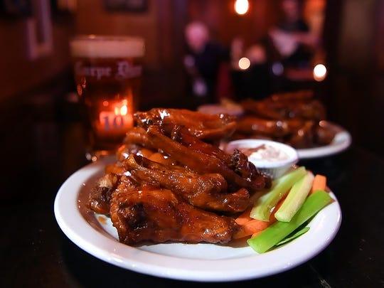 Winging it: Award-winning chicken wings at Carpe Diem on Grand Street in Hoboken.