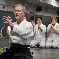 Don Luukkonen demonstrates a technique at Aikido class at Sauk Rapids-Rice High School.