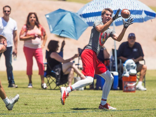 Ryan Bright of Chaparral High School, catches a pass