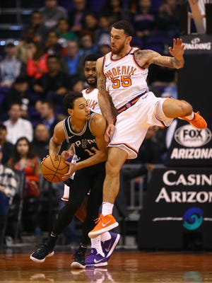Spurs guard Bryn Forbes controls the ball against Suns guard Mike James on Saturday.