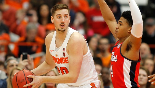 Syracuse's Tyler Lydon, left, looks to pass the ball under pressure from Mississippi's Breein Tyree, right, in the first half of an NCAA college basketball NIT game in Syracuse, N.Y., Saturday, March 18, 2017.