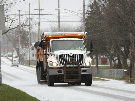 A salt truck heads up East Kalamazoo Avenue  Monday around noon, December 28, 2015, as the Lansing area prepares for ciy weather.  Several slideoffs and accidents due to icy road conditions have been reported.
