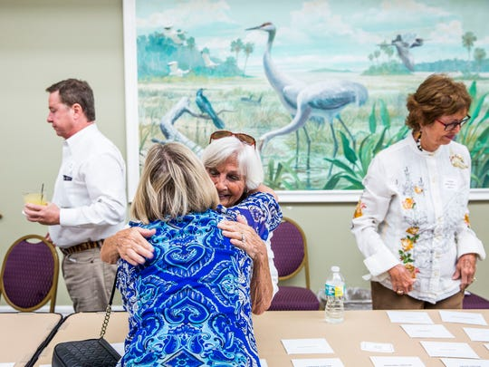 Barb Goodlette, left, and Chig Rice greet each other with a hug during the Old Timers' Reunion at the Naples Beach Hotel & Golf Club on Sunday, Oct. 1, 2017.