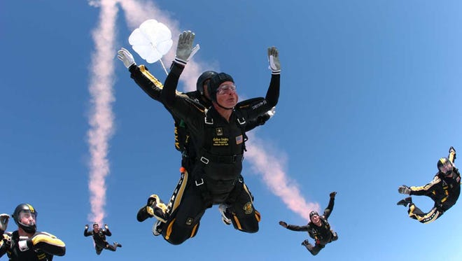 UWF graduate and U.S. Army Col. Anthony Dill jumps with former President George H.W. Bush in 2007 when Dill commanded the Golden Knights elite parachute team.
