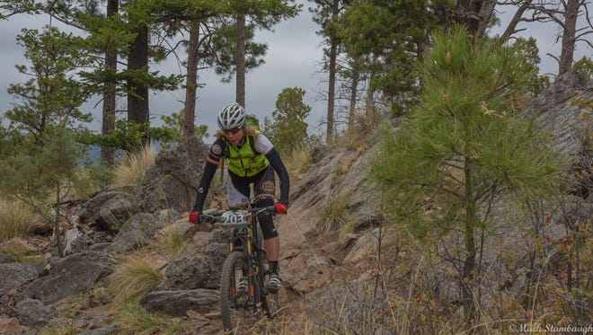 Gray skies were the backdrop as 12 Hours in the Wild West mountain bikers hit the trail at Grindstone Lake Saturday.