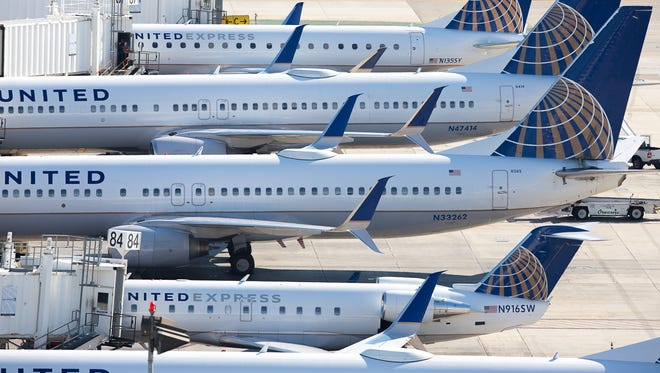 United Airlines jets line Terminal 7 at Los Angeles International Airport on Nov. 8, 2015.