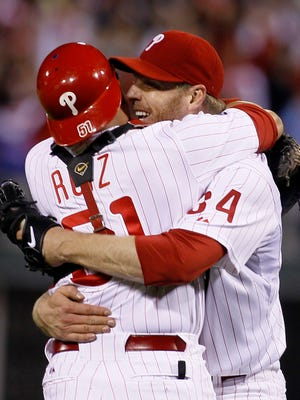 Roy Halladay celebrates with catcher Carlos Ruiz after throwing a no-hitter in the 2010 NLDS.