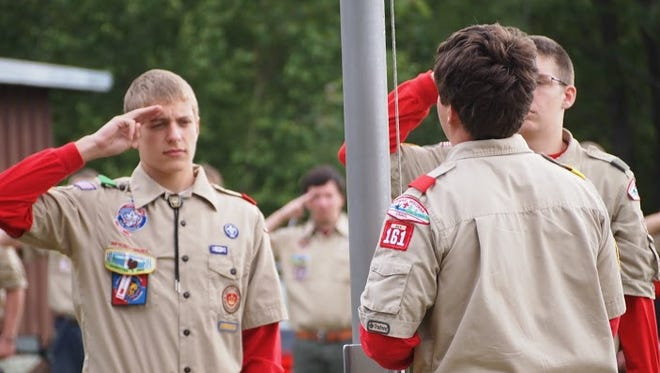 Boy Scout Troop 161 members salute the flag. The Scouts are seeking help after thieves stole their trailer parked at a church on the Far Eastside that was loaded with their camping gear.