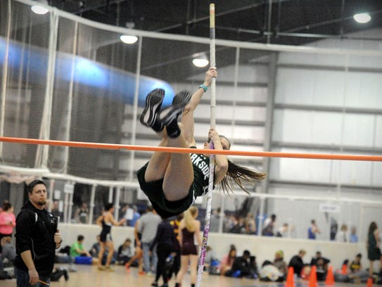 Parkside's Kara Osborne flips over the pole vault bar at the Bayside Conference championships for indoor track in 2017.