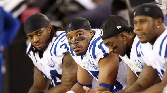 Indianapolis Colts wide receiver LaVon Brazill  (second from left) and the other offensive players sit on the bench during the Colts loss to Arizona on Sunday.