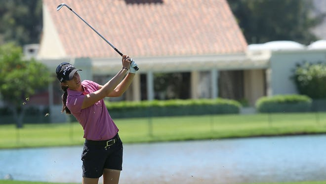 In this 2013 file photo, Nicole Castrale hits an approach shot on the 18th during the pro-am at the Kraft Nabisco Championship on April 2, 2013.