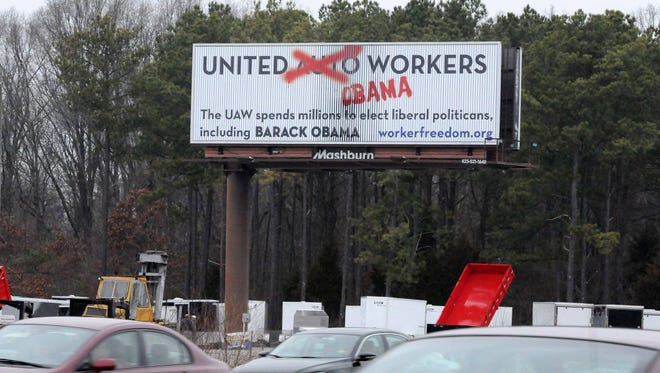An anti-UAW union message is visible on a billboard for northbound motorists in Chattanooga, Tenn. The sign misspells the word politician.