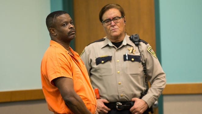 Tony Jones, left, stands during a scheduled arraignment on Tuesday, Sept. 6, 2016, at 3rd Judicial District Court. Because Jones' lawyer was not present, the hearing was rescheduled for Sept. 12.