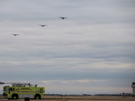 Three Coast Guard HC-144 fly over the Corpus Christi