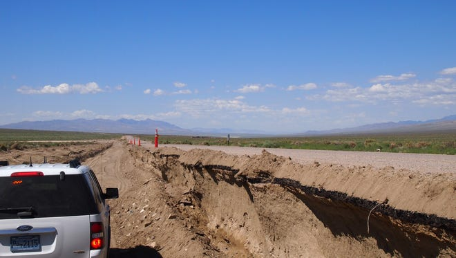 State Route 839 is ready to reopen after flash flooding washed away nearly five feet of the shoulder.