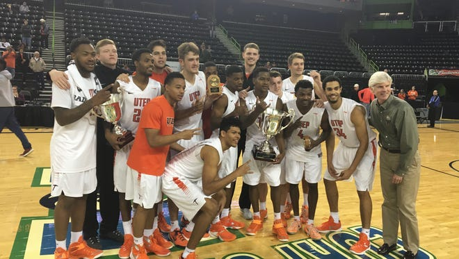 The UTEP Miners celebrate after winning the Corpus Christi Coastal Classic Tournament on Saturday.