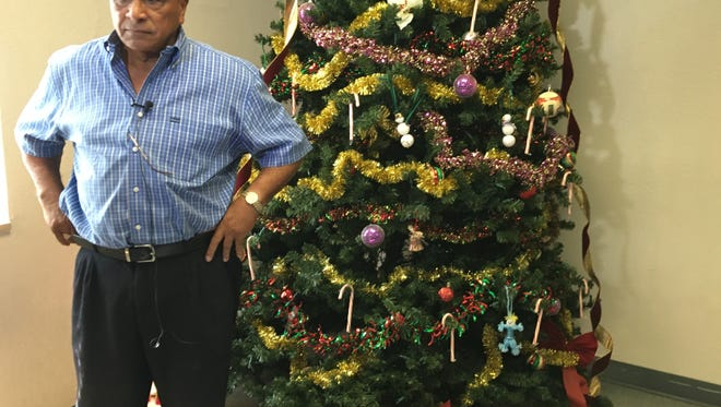 Rev. Israel Suarez, of Nations Association Charities, prepares to address the media Thursday. His organization was gifted hundreds of presents for children after his facility was broken into this week.