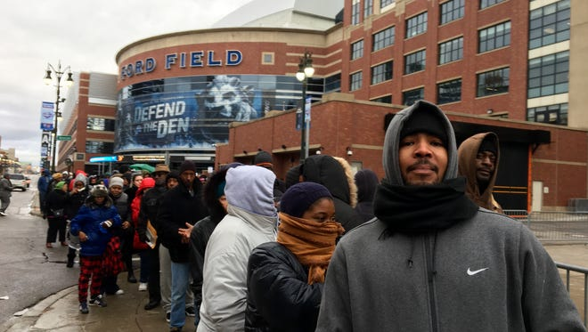 """Rashad Morgan, 31, of Detroit waits in line Dec. 29, 2015 to resolve tickets free of $200-$300 in late fees at 36th District Court's """"2-Day Holiday Sales Event."""""""