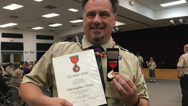 Bounty Hunter Den Leader and Assistant Cubmaster for troop 377 Chris Flicker was awarded the Honor Medal by the Boy Scouts of America Friday.