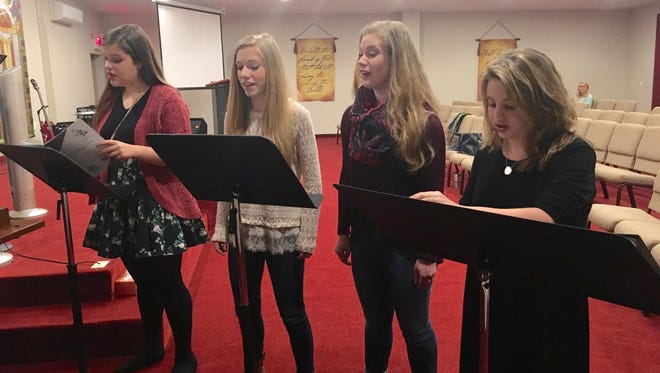 Ana Boesel, Cameron Michles, Madison Michles, and Katie Shelnut practice with their vocal instructor Hanan Taraby, before they travel to New York to perform at Carnegie Hall on Feb. 7 as part of the Honors Performance Series Program.