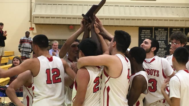 The LaBelle boys basketball team celebrates its first district title since 1998 following a 61-38 victory over Bishop Verot on Friday.