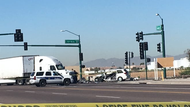 The intersection of 75th Avenue and Buckeye Road was closed after a semi-truck collided with a minivan, sending a mother and children to the hospital, on Feb. 11, 2016.
