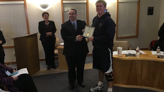 Football standout Jake Harrelson of RHS was sidelined by knee injury his senior year but his junior year was spectacular enough to get him a letter of intend with New Mexico Highlands. The school board recognized his achievement Tuesday.