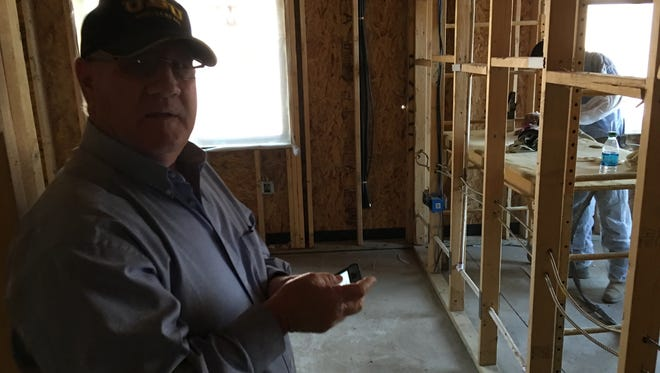 Builder Larry Skelley surveys progress in his latest assisted living center project in ruidoso.