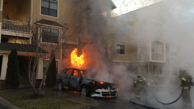 Murfresboro firefighters battled a two-care fire Thursday morning at Richland Apartments on Dill Lane.