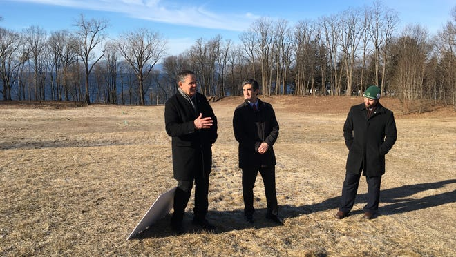 Vermont Land Trust President Gil Livingston, left, Mayor Miro Weinberger and Parks and Recreation Director Jesse Bridges on Friday announced a new city park on the former Burlington College land.