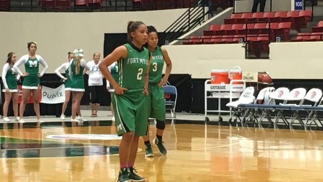 Fort Myers' Jarya Outten (2) and Destanni Henderson (3) look on during a Class 6A semifinal Friday at the Lakeland Center