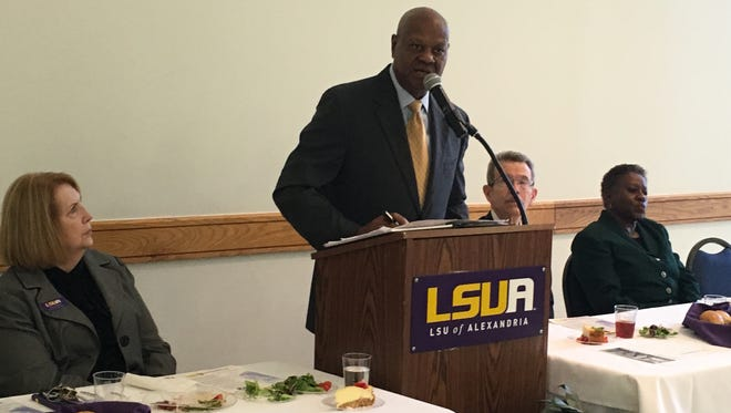Elvin L. Shields (center) speaks Thursday at a Black History Month luncheon at Louisiana State University of Alexandria. Proceeds from the annual luncheon benefit two student recipients of the Ebony Scholarship Award.